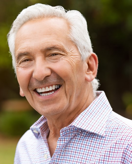 Tampa resident with his new dental implants