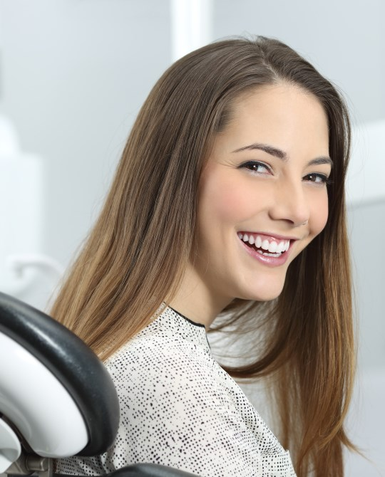 young woman in dental chair